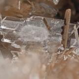Albite fromPoudrette quarry (Demix quarry; Uni-Mix quarry; Desourdy quarry), Mont Saint-Hilaire, Rouville RCM, Montérégie, Québec, Canada FOV=3mm (Author: Doug)