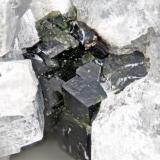 Andradite from Poudrette quarry (Demix quarry; Uni-Mix quarry; Desourdy quarry), Mont Saint-Hilaire, Rouville RCM, Montérégie, Québec, Canada FOV=5mm (Author: Doug)