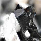 Arfvedsonite from Poudrette quarry (Demix quarry; Uni-Mix quarry; Desourdy quarry), Mont Saint-Hilaire, Rouville RCM, Montérégie, Québec, Canada FOV=5mm (Author: Doug)