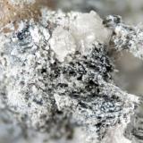Tiny plates of Bastnasite-(Ce) from Poudrette quarry (Demix quarry; Uni-Mix quarry; Desourdy quarry), Mont Saint-Hilaire, Rouville RCM, Montérégie, Québec, Canada FOV=3mm (Author: Doug)