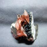 Rhodochrosite from Uchucchacua Mine, Peru size: less than 2x2x2 cubic inch. This specimen isn't with me now.it has been in my home town since last christmax.but I keep the picture .there is a double terminated Rhodochrosite crystal on matrix (Author: pro_duo)