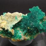 "Dioptase with Wulfenite and Calcite Mammoth-St. Anthony Mine, Tiger, Pinal County, Arizona, USA  Mined about 1959 Former Folch Collection Specimen size: 3.3 × 2.4 × 1.8 cm. Calcite fluorescent long & short UV Photo: ""Reference Specimens"" (Author: Jordi Fabre)"