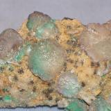 Same specimen, close up.  The fluorite is actually a pale lilac colour.  The greenish tinge to the modified crystals is due to underlying copper oxides.  Tony collected this specimen in 1969 or 1970. (Author: Ed Huskinson)