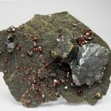 """Ruby Jack"" Sphalerite with Marcasite and Pyrite Picher Field, Tri-State District, Ottawa County, Oklahoma  USA  Mined about 1959 Former Folch duplicates collection Specimen size: 10.8 × 8.3 × 2.9 cm. Main crystal size: 3.6 × 2.9 cm. Photo: Reference Specimens (Author: Jordi Fabre)"
