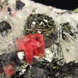 "Rhodochrosite, Pyrite, Tetrahedrite, Chalcopyrite, Quartz Steve's Pocket, Sweet Home Mine, Alma, Colorado, USA Specimen size: - cm Rhodo crystal : 1.5 cm Pyrite ""ball"" : 1.5 cm Photo: Richard Jackson (Author: chris)"
