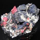Rhodochrosite, Tetrahedrite, Bornite, Quartz 04-11 Pocket, Tetrahedrite Vein,Sweet Home Mine, Alma, Colorado, USA Specimen size: 12 x 8 x 5 cm. Main rhodo crystal : 1.5 cm. Main Tetra crystal : 3.5 cm. Photo: Richard Jackson (Author: chris)