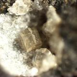 Phillipsite Sugar Grove, Pendleton County, West Virginia, USA Twinned phillipsite crystal. The crystal is 0.4 mm across the top edges. Composite of 12 images. (Author: Pete Richards)