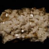Chabazite + 'mesolite' Talisker Bay, Isle of Skye, Scotland, UK Large plate 12 cm x 8 cm Chabazite crystals to 8 mm  Large plate 12cm x 8cm covered with simple white chabazite crystals to 8mm, associated with 'mesolite' needles. The specimen looks a bit dirty - I just gave it a quick rinse under the tap so's not to wash away all the 'mesolite'. Self-collected 2002 from Talisker Bay, Isle of Skye. (Author: Mike Wood)