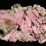 Rhodonite with Franklinite Franklin, Sussex County, New Jersey  USA Mined about 1970 Specimen size: 9.3 × 5 × 5.5 cm. Main crystal size: 2.9 × 0.8 cm. Former Folch Collection Photo: Reference Specimens (Author: Jordi Fabre)