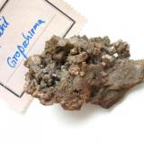 """""""Pseudoapatite"""", a pseudo of apatite after pyromorphite appearing as greyish crystals up to 4 mm on baryte matrix from the Churprinz Friedrich August mine, Großschirma, Freiberg district, Saxony. The more famous German locality for """"pseudoapatites"""" is the Lorenz Gegentrum dump, Halsbrücke, Freiberg district, Saxony. With Bergakademie Freiberg label (1930). (Author: Andreas Gerstenberg)"""