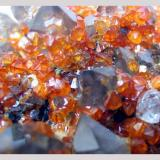 Smokey quartz crystals and spessartine garnets.  Wushan Spessartine Mine, Tongbei, Yunxiao County, Zhangzhou Prefecture, Fujian Province, China. 12 x 10 x 6 cm. (Author: Lumaes)
