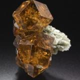 Grossular (variety Hessonite) Belvidere Mountain Quarries (Eden Mills Quarries), Vermont, USA Gail and Jim Spann Collection 1.3 x 1.9 x 1.1 cm. Photo: Jeff Scovil  This State has a double honor, to be leaded by one image of the great Jeff Scovil as well as the fact that the image is of a specimen from Gail & Jim Spann Collection! ;-)  Thank you so much to Jeff, Gail and Jim. The photo and the specimen deserves to lead this State. (Author: Jordi Fabre)