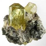 Apatite on Calcite from Cerro de Mercado Mine, Victoria de Durango, Durango, Mexico . Measures 5 x 5 x 4 cm and weighs 80 grams. Main crystal is 3.2 cm and is very gemmy (Author: VRigatti)