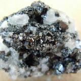 Kalahari manganese fields bixbyite crystals on calcite crystal cluster-south africa.jpg (Author: Anton Potgieter)