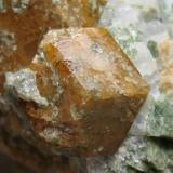 Grossular.  Maine, USA 6 x 5 cm. Close-up of the previous specimen. Detail of the smaller crystal. It could be from Casco or Limerick. See: http://www.mineral-forum.com/message-board/viewtopic.php?p=37646#37646 (Author: Antonio Alcaide)