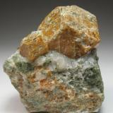 Grossular.  Maine, USA 6 x 5 cm.  Main crystal measures 3 cm. With Calcite and maybe Actinolite. It could be from Casco or Limerick. See: http://www.mineral-forum.com/message-board/viewtopic.php?p=37646#37646 (Author: Antonio Alcaide)
