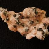 Peruvian Tertrahedrite on Rhodochrosite, about 8 cm across, and all the location info I am certain of! (Author: Darren)