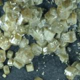 Valentinite on Pääkkönenite Caiwa Mine, Danfeng County, Shaanxi, China Close up  Specimen: William Pinch Collection Photo: Jeff Scovil & The RRUFF Project (Author: Pinch Bill)
