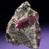 Corundum var. Ruby Mysore District, Karnataka, India 50 x 45 x 40 mm, main crystal 25 mm long (Photo © by vendor and previous owner Klaus Krause) (Author: Tobi)