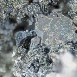 Biotite Poudrette quarry (Demix quarry; Uni-Mix quarry; Desourdy quarry; Carrière Mont Saint-Hilaire), Mont Saint-Hilaire, Rouville RCM, Montérégie, Québec, Canada FOV=4mm (Author: Doug)