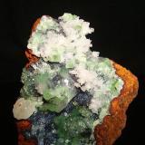 Adamite with calcite. Ojuela mine, Mapimí, Durango, México. 8cm x 5.2cm x 4cm. (Author: Luis Domínguez)