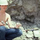 Brett Medici w. fluorite in celestite sand Lime City, Ohio, USA Fluorite cubes to 5 cm across (Author: John Medici)