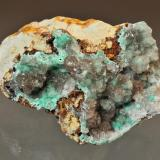 Hemimorphite with Cuprite and Aurichalcite inclusions Sunshine #4 tunnel, Blanchard Claims, Bingham, Socorro County, New Mexico, USA 8.9 x 7.6 cm Ray Demark indentified the reddish colored inclusions as being cuprite (Author: Philip Simmons)