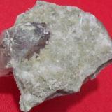 Calcite, Quartz Ghohroud, Qamsar, Kashan County, Esfahan Province (Isfahan Province; Aspadana Province), Iran FOV 9*8 cm Big Calcite with tiny Quartz crystals Calcite Size: 5 cm (Author: h.abbasi)