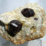 Almandin (Garnet group) Serrote Redondo, near Pedra Lavrada, Paraiba, Brazil. Overall size of mineral specimen: 6x4.5x4 cm. (Author: Leon56)