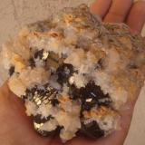 Calcite with quartz and sphalerite. Naica, Chihuahua, Mexico 12 cms the yellow inclusions in calcite are a mineral unknown for me. (Author: javmex2)