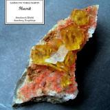 Fluorite, quartz, hematite Dörfel Quarry, Annaberg District, Erzgebirge, Saxony, Germany 65 x 30 x 15 mm, largest fluorite cubes 8-9 mm (Author: Tobi)