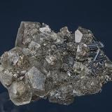 Calcite on Rutile Rist Mine, Hiddenite, Alexander Co., North Carolina, USA 2.8 x 2.1 cm. (Author: am mizunaka)