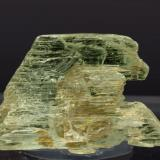 Spodumene (variety Hiddenite) Stony Point (Hiddenite), Alexander County, North Carolina, USA Specimen size: 3.2 × 2.2 × 0.8 cm. Minor fluorescence short UV Photo: Reference Specimens (Author: Jordi Fabre)