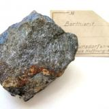 Berthierite, antimonite Neue Hoffnung Gottes mine, Bräunsdorf, Freiberg, Erzgebirge, Saxony, Germany. 6 x 5 cm Bluish berthierite in massive antimonite ore. With late 1920s label. (Author: Andreas Gerstenberg)