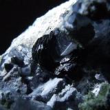 Blue Quartz  and Hematite La Juanona quarry, Antequera, Málaga, Andalusia, Spain Approx 4 mm across (Author: nurbo)
