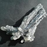 Stibnite on and covered with quartz Kadamjai mine 8 x 3 cm (Author: alex chaus)