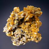 Wulfenite Zelidja Mine, Touissit, Oujda-Angad Prov., Morocco 6.3 x 6.9 cm. Tabular yellow wulfenite crystals to 1.0 cm on edge. (Author: crosstimber)