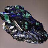 Azurite Tsumeb Mine, Tsumeb, Namibia 4.5 x 6.7 cm. Parallel growth of lustrous dark blue azurite crystals partially altered to malachite. (Author: crosstimber)