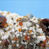 Spessartine, orthoclase, quartz Wushan Spessartine Mine, Tongbei, Yunxiao Co., Zhangzhou Prefecture, Fujian Province, China 93 mm x 49 mm x 36 mm  Close-up view (Author: Carles Millan)