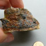 Uraninite, Gummite Ty Gallen Mine, Morbihan, Brittany Area, France. 45*30 mm  Uraninite (black) with Gummite (brown and yellow) Same specimen (Author: Benj)