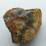 Uraninite, Gummite Ty Gallen Mine, Morbihan, Brittany Area, France. 70*50 mm  Uraninite (black) with Gummite (brown and yellow) Same specimen (Author: Benj)
