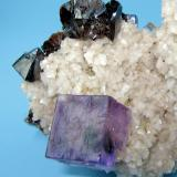 Fluorite, sphalerite, dolomite. Elmwood Mine, Carthage, Smith County, Tennessee, USA 90 mm x 60 mm x 52 mm  Close-up view  Note that a sphalerite crystal is enclosed into the fluorite (Author: Carles Millan)