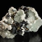 Fluorite Gibraltar Mine, Naica, Mun. de Saucillo, Chihuahua, Mexico 5.5 x 7.7 cm. Light green cubic fluorite crystals on lustrous black sphalerite with white calcite, octahedral galena, and brassy yellow pyrite in association. (Author: crosstimber)
