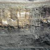Las Cruces mine, Gerena, Seville, Spain View of the contact zone between yellow gossan, black gossan and secondary copper sulfide ore (Author: Cesar M. Salvan)