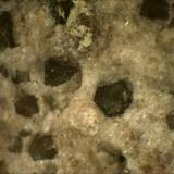 Zunyite Purple Cow Ledge, Near Quartzite, Arizona, USA 1mm x 1mm x 1mm (Author: Mark Ost)