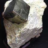 Pyrite Ampliación a Victoria Mine, Navajún, La Rioja, Spain 10 x 8 x 8 cm. Two grouped crystals in matrix. It´s a curious specimen with a small elongated crystal inside of a bigger cubic one. (Author: supertxango)