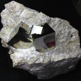 Pyrite Ampliación a Victoria Mine, Navajún, La Rioja, Spain 9 x 9 x 7 cm. Three grouped pyrite crystals in matrix. It has a very brilliant and smooth faces similar to a mirror. (Author: supertxango)
