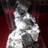 Pyrite and quartz Bucium, Romania 5 cm (about 1 cm main crystal) (Author: David)