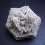 Dolomite pseudomorph after aragonite Cottonwood Draw, Chaves Co., New Mexico, USA 7,5 x 6 x 5 cm Grainy dolomite after a cyclic twin of aragonite, well, several twins. (Author: Antonio Alcaide)