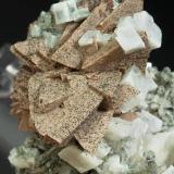 Helvite, genthelvite, quartz, calcite Huanggang Mine, Kèshíkèténg Qí, Chifeng, Inner Mongolia A.R., China 75 mm × 52 mm × 37 mm. Main crystal size: 15 mm × 13 mm  Close-up (Author: Carles Millan)